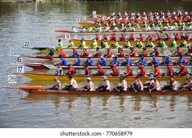 kuching sarawak, malaysia november17 2017 : the paddle boat race with different colours at river during sarawak regatta 2017 at kuching city