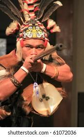 KUCHING, SARAWAK, MALAYSIA - SEPTEMBER 13: The Iban Warrior demonstrating a traditional dart at the Sarawak Cultural Village on September 13, 2010 in Santubong, Sarawak.