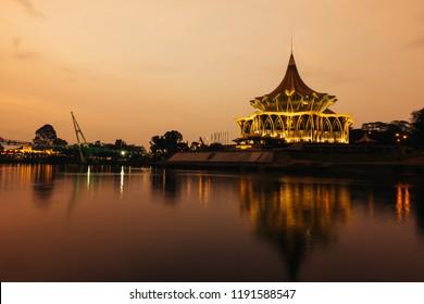 "Kuching, Sarawak, Malaysia - September 2018: The new Sarawak State Assembly building (Dewan Undangan Negeri) with its distinctive ""payung"" (umbrella) roof is the state parliament of Sarawak."