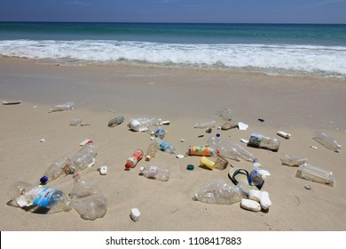 KUDAT, MALAYSIA - CIRCA JUNE 2018: Plastic pollution environmental problem. Plastic bottles and other garbage washes up on beach