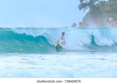 KUDAT SABAH, MALAYSIA - DEC 31, 2016: Unidentified surfer executes a radical move on a beautiful ocean wave.