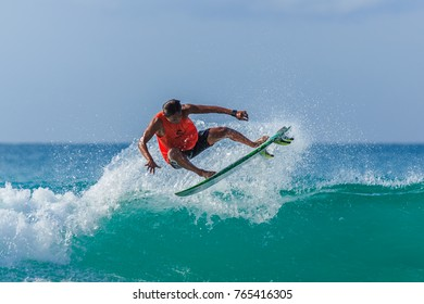 KUDAT SABAH, MALAYSIA - NOV 25, 2017: Unidentified surfer executes a radical move on a beautiful ocean wave.