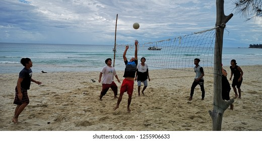 Kudat, Sabah-Dec 2, 2018: A group of fishermen seen playing volleyball at the beach after spending a long day out at the South China Sea.