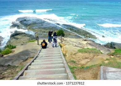 Kudat,Sabah,Malaysia-Feb 3,2018:Group of tourist enjoying the view of Tip of Borneo in Kudat,Sabah,Malaysia.Its northern most tip is the meeting point of two big oceans,South China Sea & Sulu Sea.