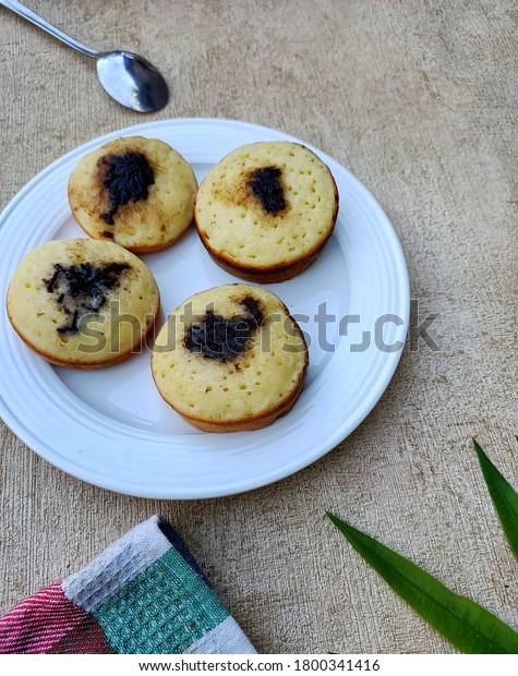 Kue Pukis On White Plate Pukis Stock Photo Edit Now 1800341416