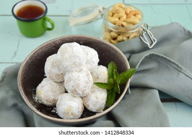 "Kue Putri Salju Kacang Mede or ""snow princess"" white ball cookies made from cashew, egg yolk, flour, corn stach and butter coated with powdered sugar. Popular cookie to celebrate Eid al Fitr"