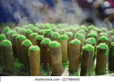 Kue putu or putu bambu/traditional cylindrical-shaped and green-colored steamed cake