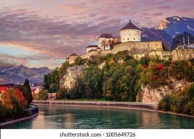 Kufstein Old Town with medieval fortress on a rock  over the Inn river, Alps mountains, Austria, in dramatic sunset light