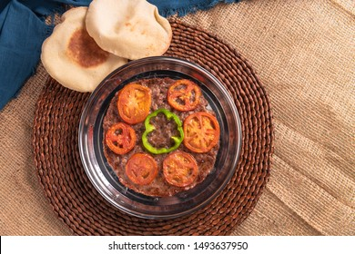 Kufta - Kofta with Tomato Tray Top View Styled and Garnished on a Plate
