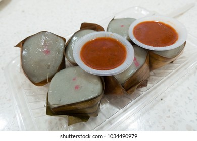 Kuih Kochi, a Malay dumpling (kuih) made from glutinous rice flour, and stuffed with coconut fillings with palm sugar.