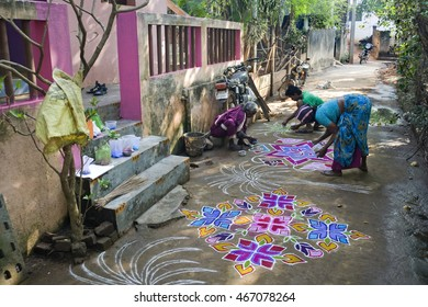 KUILAPALAYAM, INDIA - January 16, 2015: Kolams drawn in a tamil village during Pongal harvest festival.