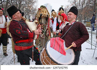 """Kukeri, mummers perform rituals with costumes and big bells, intended to scare away evil spirits during the international festival of masquerade games """"Surva"""" in pernik, Bulgaria – 01/26/2019. Folklor"""