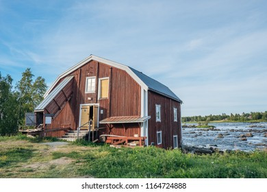 KUKKOLA, SWEDEN - AUGUST 8, 2018: Fishermans building on the Swedish side of Torne river. Kukkola rapids has been a fishing site since medieval times.
