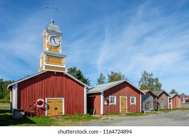 KUKKOLA, SWEDEN - AUGUST 8, 2018: Fishermans cottages and sheds on the Swedish side of Torne river. Kukkola rapids has been a fishing site since medieval times.
