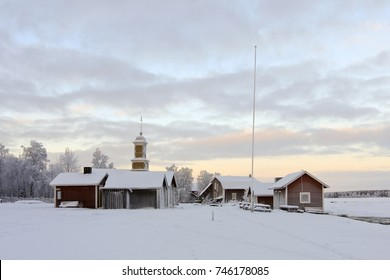 KUKKOLAFORSEN, SWEDEN ON DECEMBER 14. View of old wooden buildings, village covered by frost and snow on December 14, 2010 in Kukkolaforsen, Sweden. River to the right.