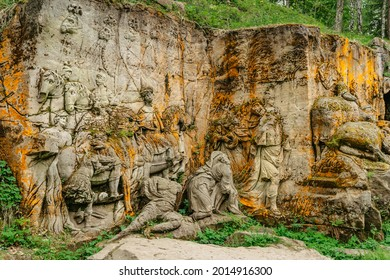 Kuks, Czech Republic - May 23, 2021.Braun's Bethlehem. Group of sculptures and reliefs carved into the rock created by famous author Matyas Braun.National heritage site in wilderness of the forest.