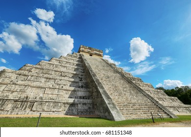 "Kukulcan Mayan pyramid ""El Castillo"" with the sun rising from behind, Chichen Itza, Mexico"