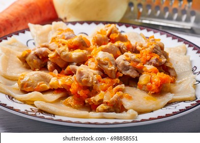 Kulchetay - traditional dish of Kyrgyz cuisine. Hinkal, Beshbarmak for lunch. Pieces of meat with carrots and onions, layers of boiled dough, pasta. Delicious breakfast, lunch, dinner in a cafe.