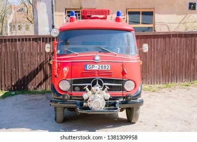 Kuldiga, Latvia - April 21 2019: Vintage fire truck Daimler Mercedes Benz  converted to a mobile beer bar.