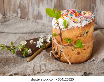Kulich cake with young green sprigs, symbol of Traditional Russian Orthodox Easter