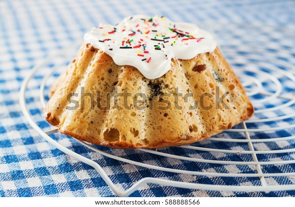 Kulich, Russian Easter bread with a protein cap and colored sprinkles