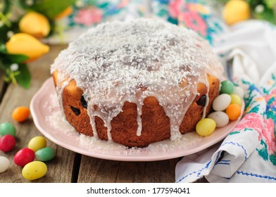 Kulitch (Kulich), Russian Easter Bread Topped with Sugar Icing and Dessicated Coconut, Decorated with Easter Eggs Candies
