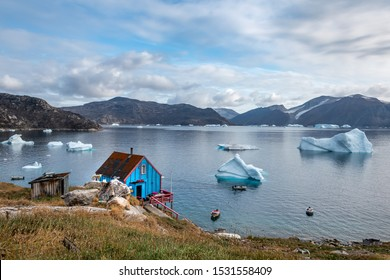 Kullorsuaq village,Greenland - August 20,2019 Traditional  Fishing and hunters village beyond the Arctic Circle, north lasndscape with icebergs