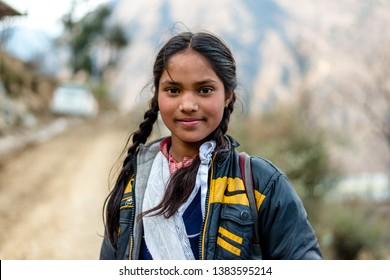 Kullu, Himachal Pradesh, India - March 01, 2019 : Portrait of himalayan girl in himalayas - India