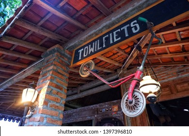 kulon progo,yogyakarta - may 11 2019: javanese joglo house with old and vintage stuff at Towil Fiets,rural tourism located in kulon progo,get around the village using classic roadster bicycle