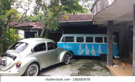 Kulon progo,yogyakarta-april 6 2019: Silver volkswagen bug and blue combi parked in the garage