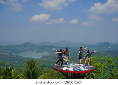 Kulonprogo, Yogyakarta, Indonesia 12th of May 2018. People was enjoying beautiful view of Pule Payung in Menoreh hill, Yogyakarta, Indonesia