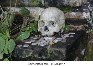 Kuluran Terunyan Cemetery in Bali where bodies are buried above ground and where visitors leave money offerings to the dead. as part of a combined pagan-Hindu belief.