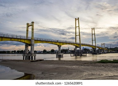 Kumala Island Bridge on Mahakam River, landmark of Tenggarong City, in Kutai Kartanegara, East Kalimantan, Indonesia.
