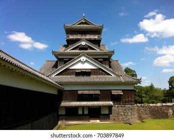 Kumamoto Castle with stone walls; Japanese Castle