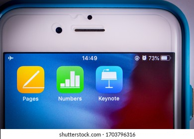 Kumamoto, Japan - Apr 5, 2020 : Icons of iWork (Pages, Numbers & Keynote) on iPhone screen. iWork is an office suite of applications created by Apple Inc.