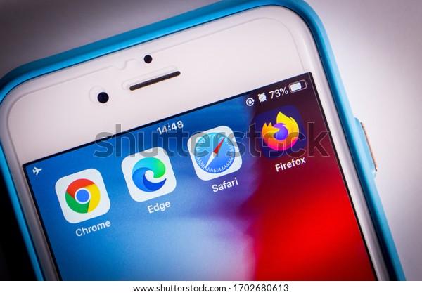 Kumamoto, Japan - Apr 5, 2020 : Icons of top four modern web browsers (Google Chrome, Microsoft Edge, Safari & Firefox) on iPhone screen.