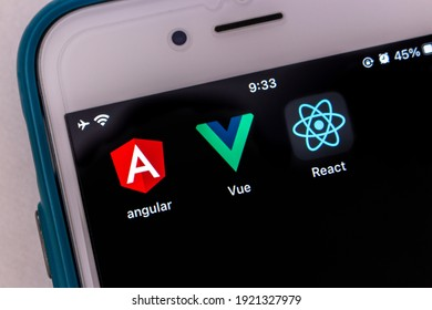Kumamoto, JAPAN - Feb 15 2021 : Concept image three icons of modern JS libraries (Angular, Vue.js and React) on iPhone.