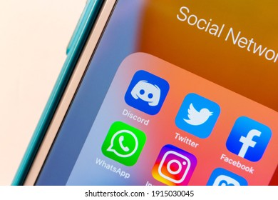 Kumamoto, JAPAN - Feb 8 2021 : Discord app, VoIP, instant messaging and digital distribution platform for users, with popular SNS icons (Twitter, Facebook, WhatsApp, Instagram and Mastodon) on iPhone