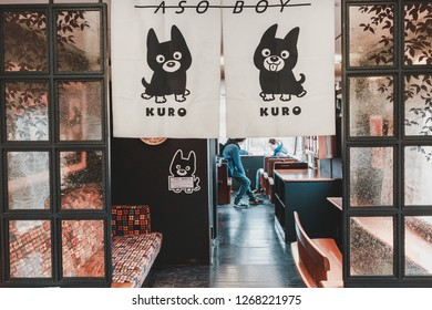 "Kumamoto, Japan - January 3, 2016: Interior of Aso Boy train with its mascot ""Aso Kuroemon"" printed on all furniture. The train is run by JR (Japan Railway) Kyushu Company from Kumamoto."