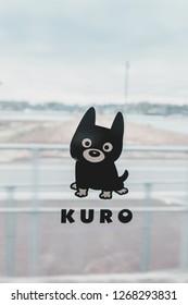 """Kumamoto, Japan - January 3, 2016: Interior of Aso Boy train with its mascot """"Aso Kuroemon"""" on the windows. The train is run by JR (Japan Railway) Kyushu Company from Kumamoto."""