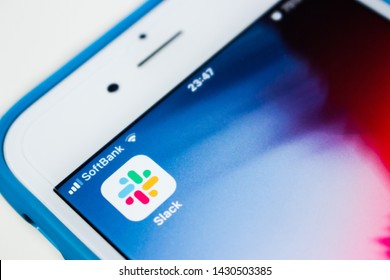 Kumamoto, Japan - June 22, 2019 : Close up view of Slack app of iOS on an iPhone with Softbank SIM. Slack was founded in 2009. In 2019, Slack's listed on NYSE and stock begins on trading.