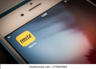 Kumamoto, Japan - May 29 2020 : Hertz app on iPhone. Hertz is an US car rental company based in Estero, Florida, that operates 10,200 corporate and franchisee locations internationally.