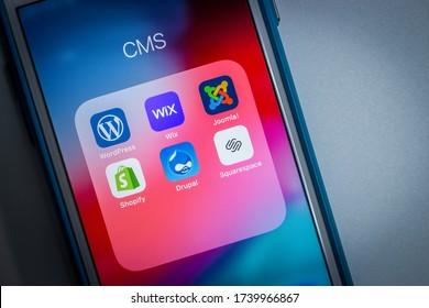 Kumamoto, Japan - May 7 2020 : Popular CMS icons (WordPress, Wix, Joomla!, Shopify, Drupal and Squarespace) on iPhone screen.