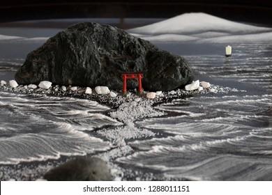 Kumamoto, Japan - November 11, 2018:  Bonseki ,tray rocks, is the ancient Japanese art of creating miniature landscapes on black lacquer trays