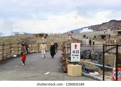 Kumamoto, Japan - November 21, 2018: Many tourists are walking in and out Aso crater entrance, Mount Aso, Kumamoto, Japan.