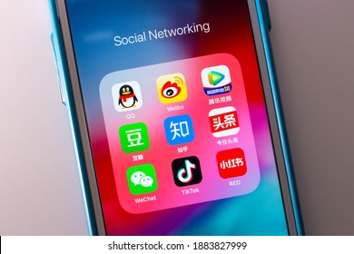 Kumamoto, JAPAN - Oct 3 2020 : The Chinese Popular Social Media Services Icons (Tencent QQ, Sina Weibo, Tencent Video, Douban, Zhihu, Jinri Toutiao WeChat, TikTok, Xiao Hong Shu) on iPhone Screen.