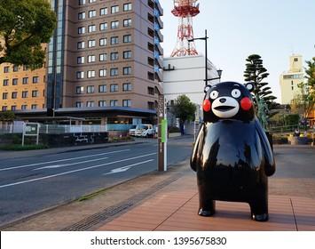 "Kumamoto, JP - APRIL 3, 2019: The giant black bear mascot statue ""Kumamon"" is decorating on the main street in Yatsushiro downtown, Kumamoto, Japan."