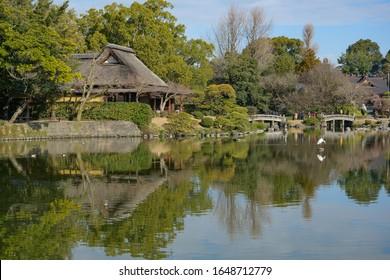 KUMAMOTO, KYUSHU, JAPAN - JANUARY 29, 2020: View of Suizenji Jojuen park, a Japanese ornamental garden in Kumamoto