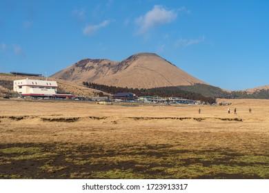 Kumamoto Prefecture, Japan - JAN 4 2020 : Kusasenri (kusasenri-ga-hama) prairie in Aso Kuju National Park. Aso Volcano Museum, shops, cafe, and restaurant are adjoining the large parking area