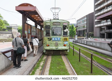 KUMAMOTO,JAPAN - MAY 28,2014 : The Kumamoto city tram at Kumamoto station. This tram operated by The Kumamoto city transportation Bureau. Kumamoto city tram has 2 lines.